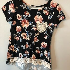 Flower shirt with lace detailing.